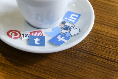 CHIANG MAI, THAILAND - SEPTEMBER 24, 2014: Social media brands printed on sticker and placed on hot coffee cup morning life. Editorial