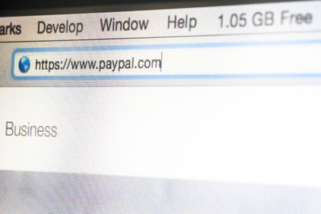 CHIANG MAI, THAILAND - OCTOBER 22, 2014: Paypal website address bar close up on laptop screen. PayPal is an American international e-commerce business allowing payments and money transfers. Editorial