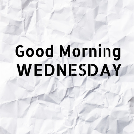 workday: Good Morning Wednesday on White paper texture and background. Stock Photo