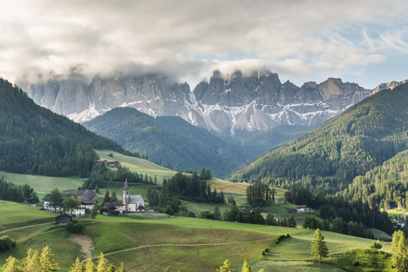 odle: Santa Maddalena village in front of the Geisler or Odle Dolomites Group, Val di Funes, Italy, Europe. Stock Photo