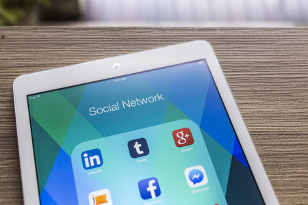 CHIANG MAI, THAILAND - OCTOBER 21, 2014: All of popular social media icons on Apple ipad air tablet device screen.