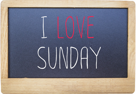 workday: I love Sunday on Blank blackboard isolated on white background. Stock Photo