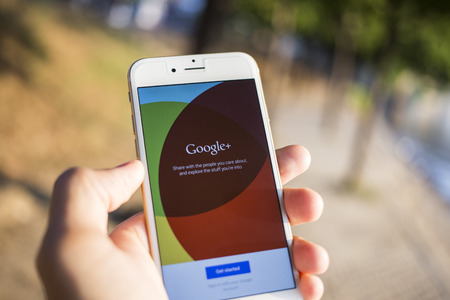 CHIANG MAI, THAILAND - JANUARY 04, 2015: Man hold Apple iphone 6 with Google+ social network of the Google company. Information of a social network, influences Google search results. Editorial