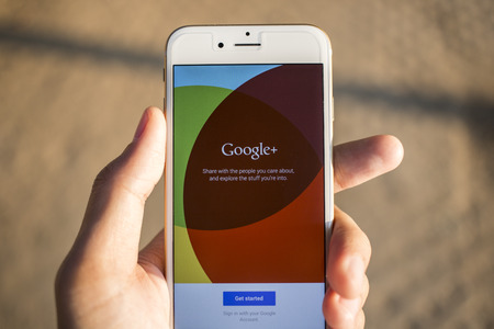 search results: CHIANG MAI, THAILAND - JANUARY 04, 2015: Man hold Apple iphone 6 with Google+ social network of the Google company. Information of a social network, influences Google search results. Editorial