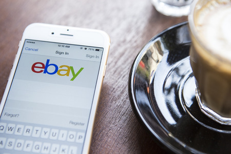 mai: CHIANG MAI, THAILAND - APRIL 22, 2015: Close up of ebay app on a Apple iPhone 6 screen. ebay is one of the largest online auction and shopping websites.