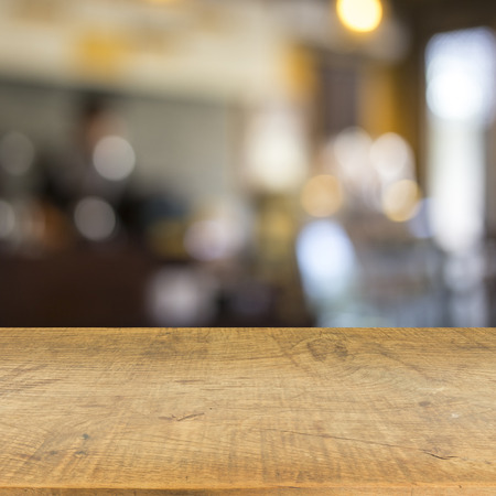 Blur cafe and wood floor texture background