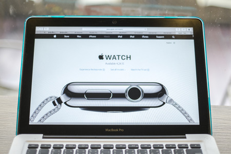 macbook: CHIANG MAI, THAILAND - March 10, 2015: Apple Computers website close up details on Apple Macbook Pro with the Apple Watch wearable technology device.
