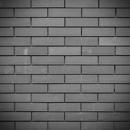 clay brick: Black and grey Brick wall texture and background