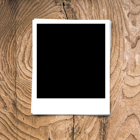 frame border: blank photo frame on brown wood background texture