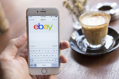 ebay: CHIANG MAI, THAILAND - APRIL 22, 2015: Close up of ebay app on a Apple iPhone 6 screen. ebay is one of the largest online auction and shopping websites.