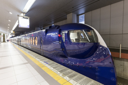 to depart: OSAKA,JAPAN, FEB 09: Nankai train depart from Osaka station on 09 february 2015. Rail transport services are well developed in Japan and they are provided by more than 100 private companies.