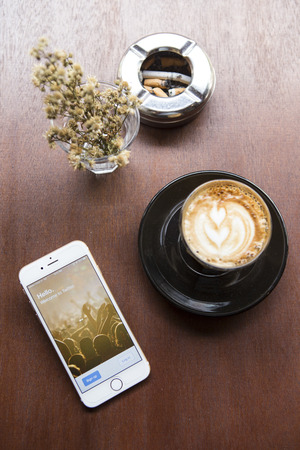 microblog: CHIANG MAI, THAILAND - APRIL 22, 2015: Log in page Twitter application using Apple iPhone 6 in coffee shop. Twitter is largest and most popular social networking site in the world.