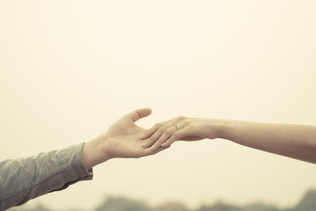 color tone: Couple hand together touch with love vintage filter tone.
