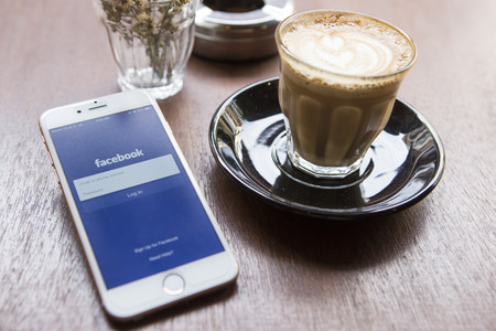 CHIANG MAI, THAILAND - APRIL 22, 2015: Facebook application using Apple iPhone 6. Facebook is largest and most popular social networking site in the world. Editorial