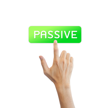 passive income: Passive income button with real hand isolated on white