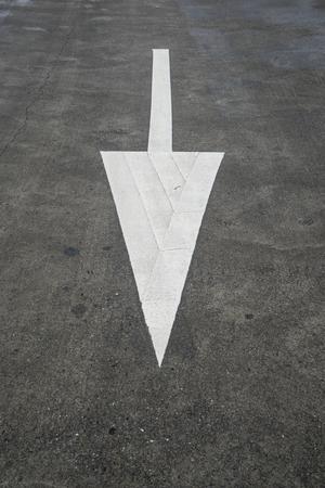 slow lane: Arrow sign on texture road. Stock Photo