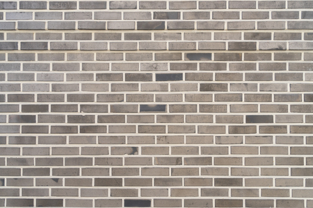 Gray pattern brick wall texture and background.