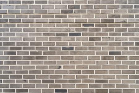 Textura gris de la pared del modelo del ladrillo y el fondo.