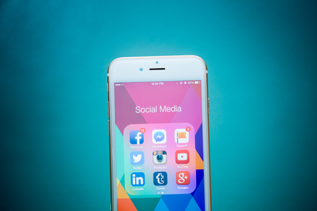 tumblr: CHIANG MAI, THAILAND - SEPTEMBER 02, 2015: All of popular social media icons on smartphone device screen Apple iPhone 6 on blue background.