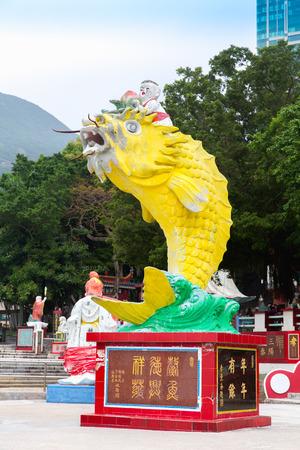 repulse: Big Yellow Fish Statue in Guan Yin Temple at Repulse Bay, Hong Kong
