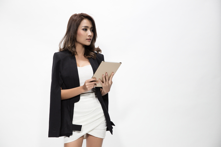 business woman working: Beautiful young business woman holding and working with a tablet, isolated white background.