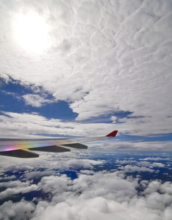 descend: cloudy sky with airplane wing
