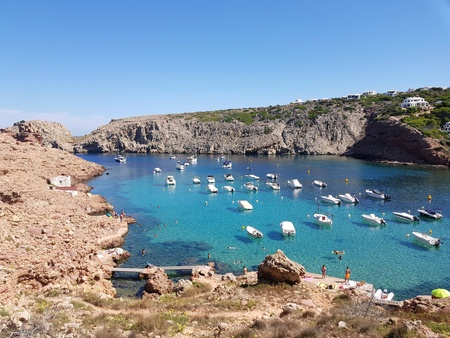 Water turquoise with boat, Cala morell, Minorca