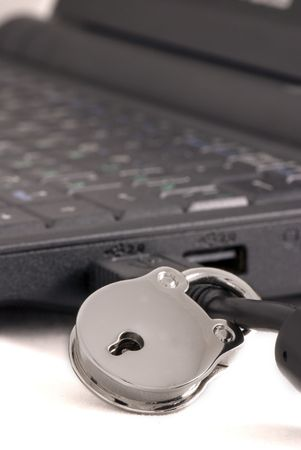 Padlock on a usb cable connected to computer Stock Photo - 4307742