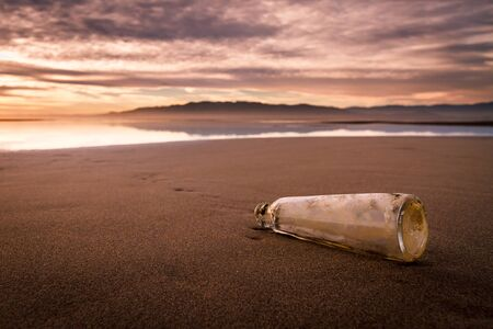 Bottle on the beach with important message