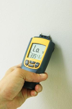 metering moisture in wall painting photo