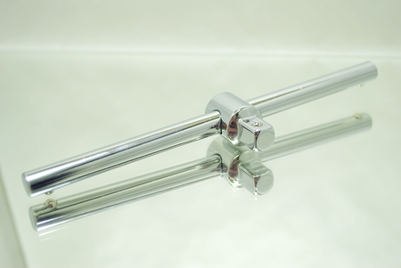 socket wrench manual handle closeup on mirror