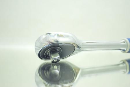 ratchet socket wrench closeup on mirror