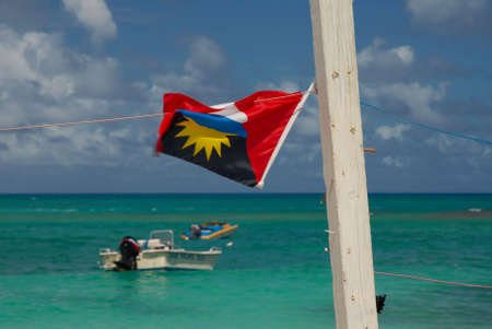 antigua flag: Antigua flag against the ocean