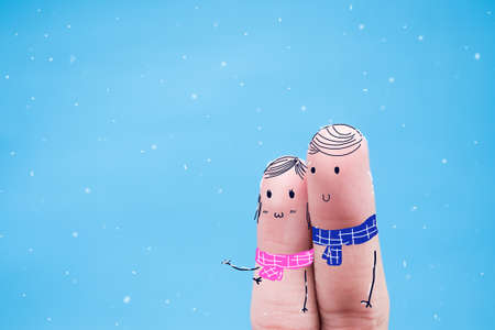 ice storm: Creative idea finger.Finger art of a Happy couple.Winter scene of shivering man in snowstorm or ice storm Stock Photo