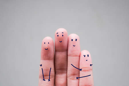 Fingers Family a Happy in holiday.gesture, family, people and body parts concept - close up of two hands showing fingers with smiley faces Stock Photo