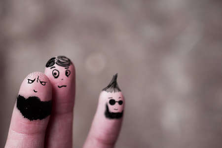 bloodlines: Three school boy friends finger puppets hugging and having fun together.