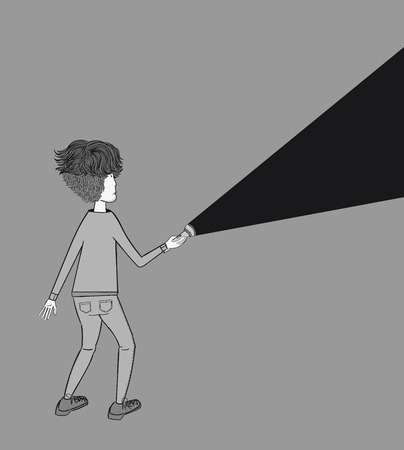 A young man holding a flashlight shines in the dark.Concept of searching, adventure, secrecy.
