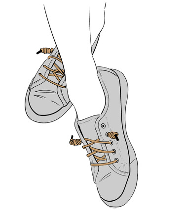 Female legs in fashion sneakers. Isolated on a white background