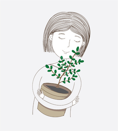 Cute girl hugging her own planted trees. She loves her tree so hopefully someday it will grow beautiful under the shade and utilize the benefits.
