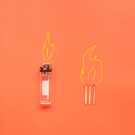 white lighter isolated on a orange background.creative idea.Flat lay.