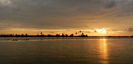 Orange sunset on the backwaters of Kerala, Southwest India                                 Stock Photo