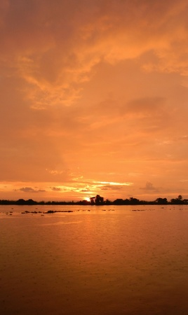 Orange sunset on the backwaters of Kerala, Southwest India                                 Stock Photo