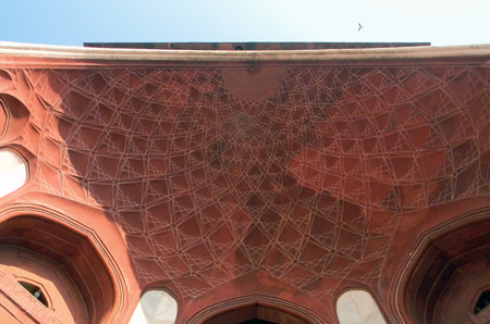 Decorated main gate cupola, and arched portal to the Taj Mahal site in Agra, India