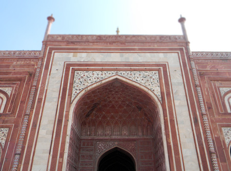 Main Gate of Taj Mahal mausoleum with entry portal perspective in Agra, India Stock Photo