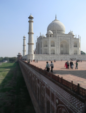 Exterior wall view of the Taj Mahal mausoleum with dome and minaret towers Stock Photo