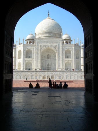 adjacent: Iconic view of the Taj Mahal mausoleum in Agra, India, from an arched portal of the adjacent mosque