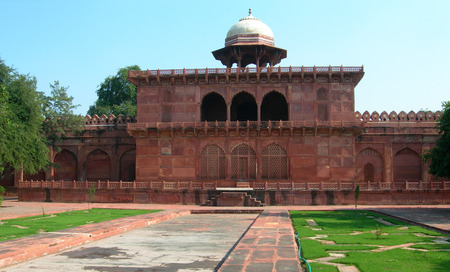 Red sandstone arches and temple near the Taj Mahal mousoleum complex in Agra, India Stock Photo
