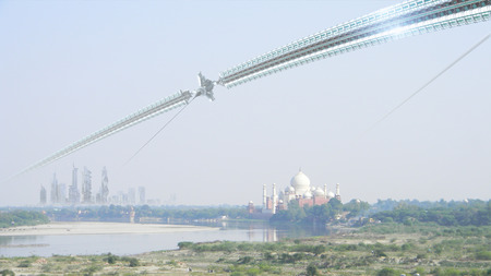 india 3d: Science fiction technological architecture of a city skyline with skyscrapers space elevator and wheel  composed with the Taj Mahal Uttar Pradesh India for futuristic or fantasy backgrounds Stock Photo