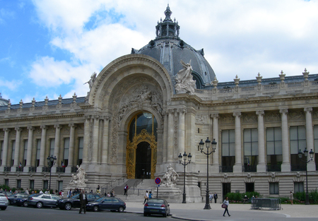 building monumental: Classic building with colonnade, monumental entry and baroque architecture in Paris, France