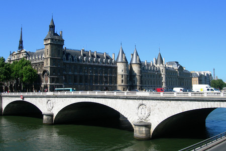 Classic architecture with Palais de Justice castle and bridge over Seine river in Paris, France